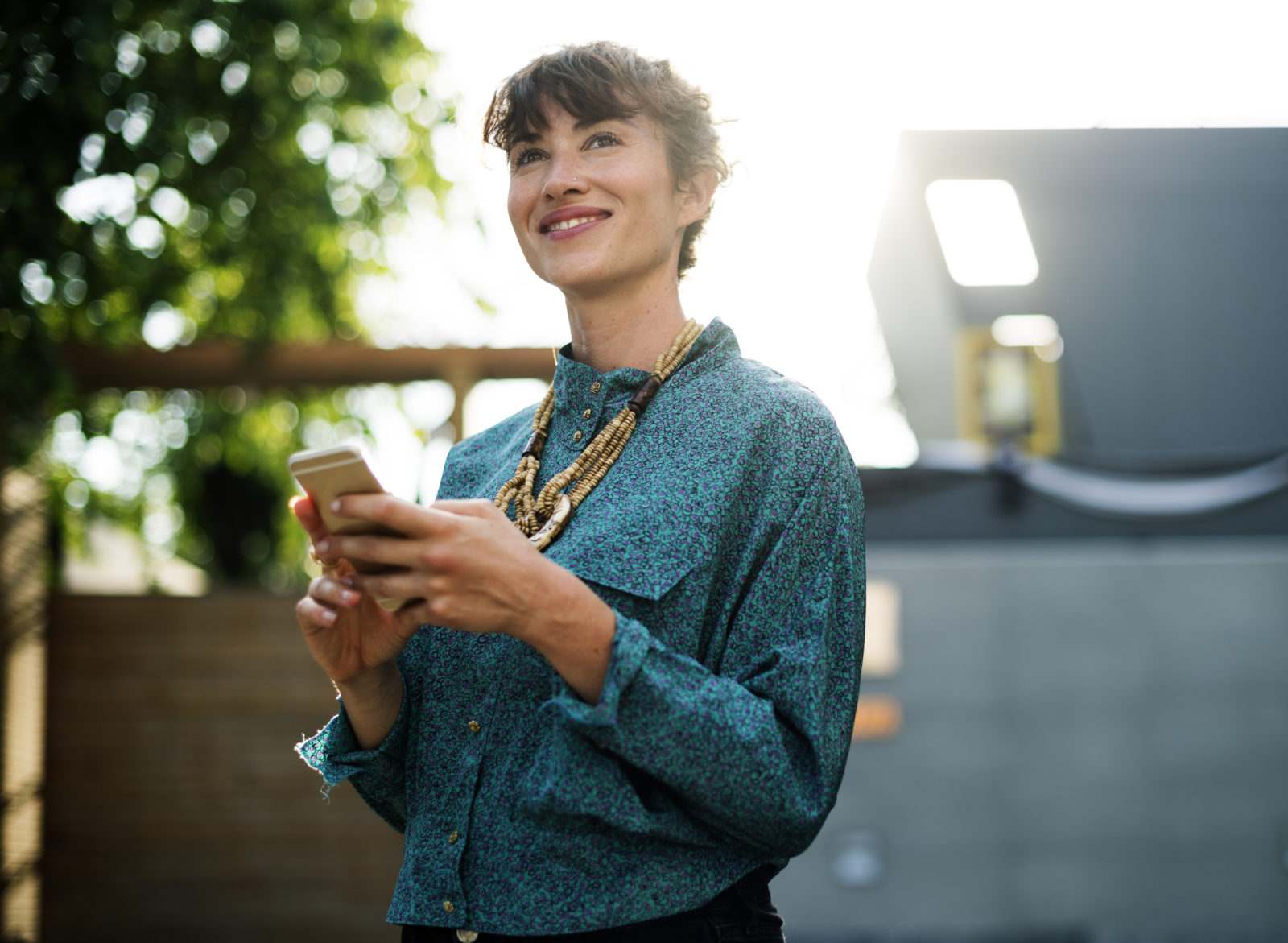 Businesswoman standing and using mobile phone to find ideal job candidates.
